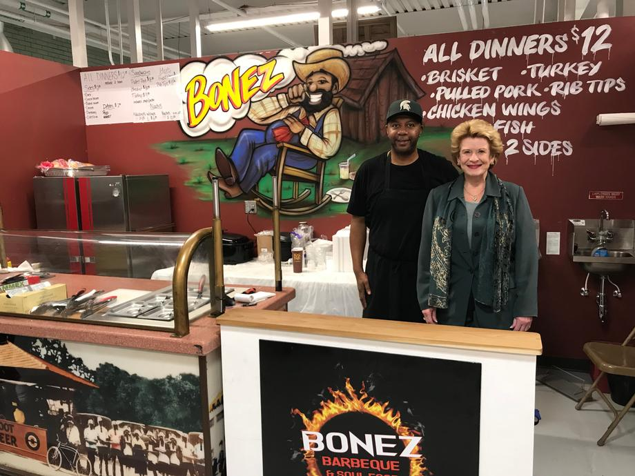Senator Stabenow and a constituent at Bonez Barbecue in  the SVRC Market Place in Saginaw, MI