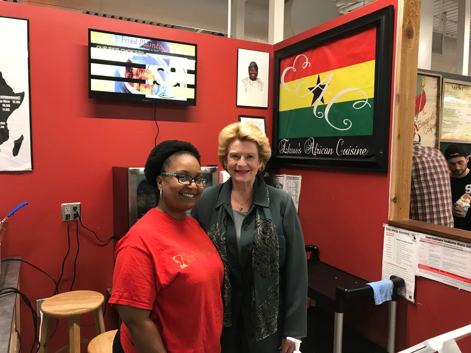 Senator Stabenow and a constituent at Ekow's African Cuisine in the SVRC Market Place in Saginaw, MI