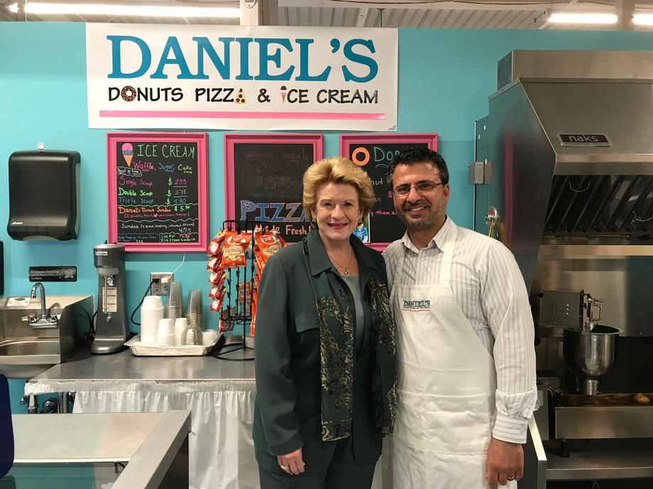 Senator Stabenow and a constituent at Daniel's Donuts, Pizza and Ice Cream in the SVRC Market Place in Saginaw, MI
