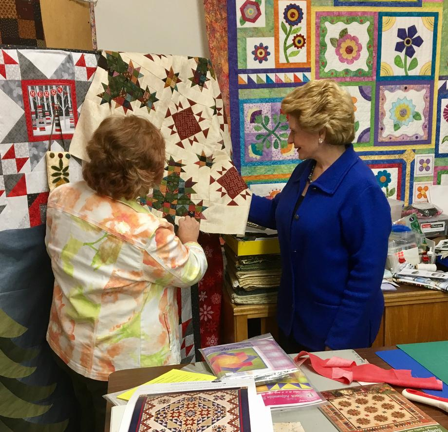 Senator Stabenow viewing the beautiful quilts at Around the Block Quilt Shop in Portland.